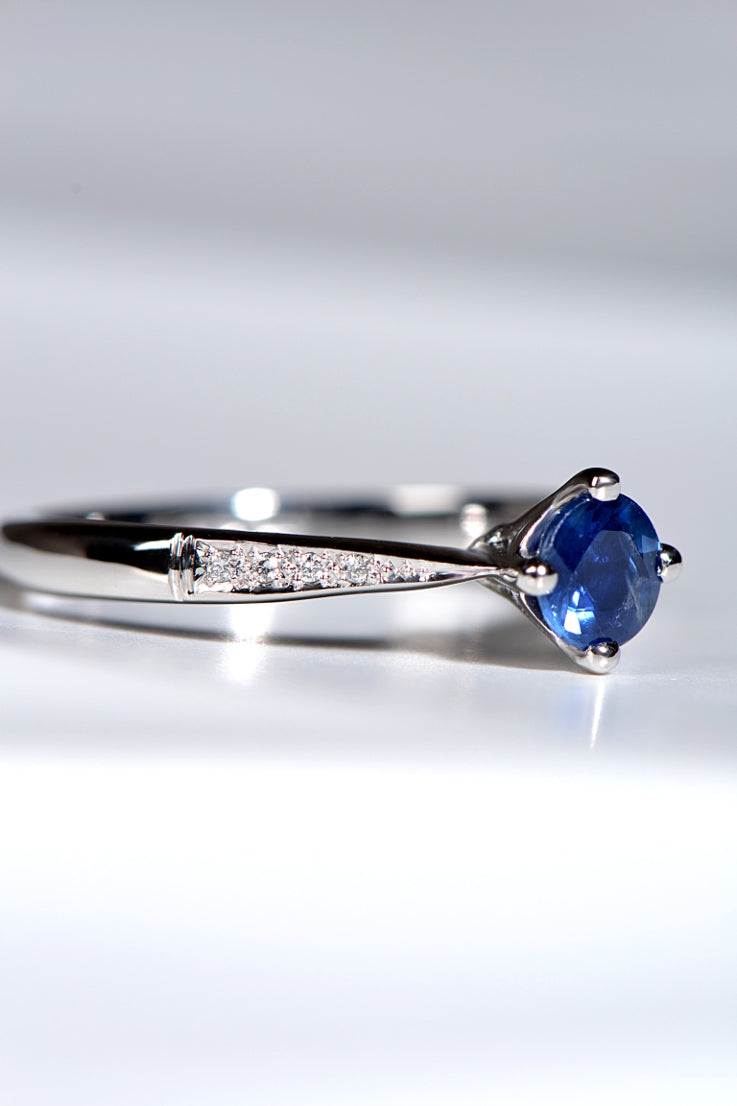 Platinum and sapphire engagement ring with diamonds