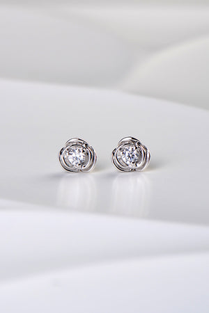 silver-rose shaped earrings with a round cz in the middle