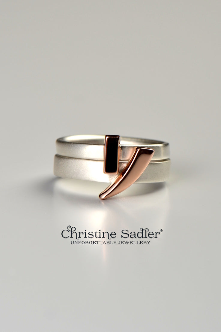 Cairn silver ring with rose gold detail