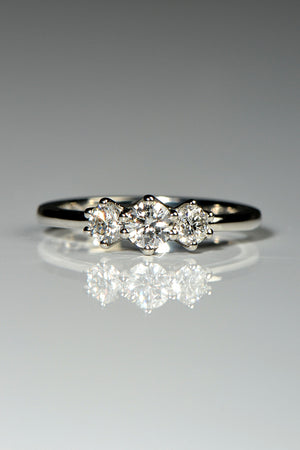 three stone platinum ring with cathedral setting