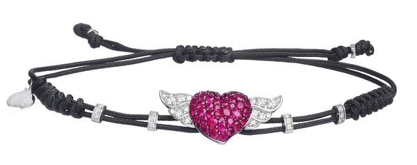 BRACELET WITH HEART  AND  WINGS IN GOLD WITH RUBIES AND DIAMONDS