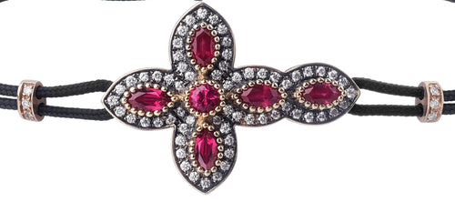 BRACELET WITH CROSS IN GOLD WITH DIAMONDS AND RUBIES