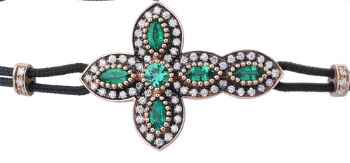 BRACELET WITH CROSS IN GOLD WITH DIAMONDS AND EMERALDS