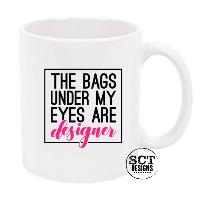 THE BAGS UNDER MY EYES ARE DESIGNER - COFFEE MUG