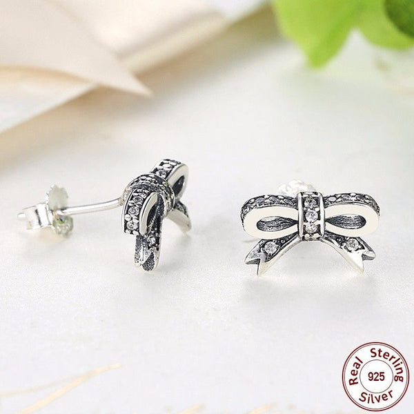 PAIR OF SPARKLING DELICATE BOW STUDS