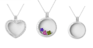 Glass lockets with elements containing ashes set in resin