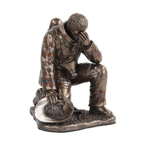 5.75 Inch Bronze Colored Fireman Reflecting on One Knee Figurine