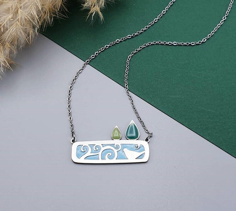 Stainless steel bird house necklace
