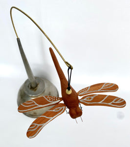 Dragonfly in Vintage oil can