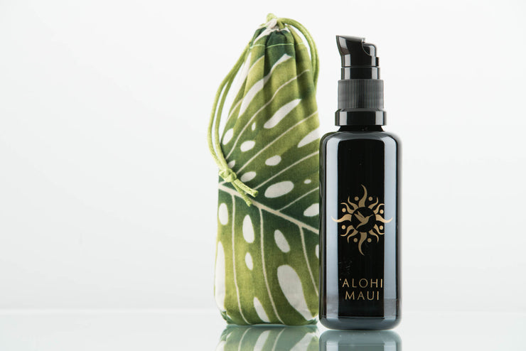 'Alohi Rainwater Essence in a Refillable Miron Glass Bottle
