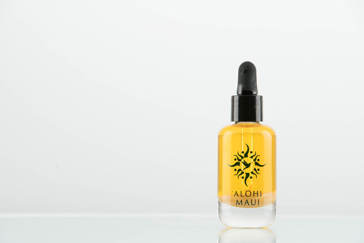 'Alohi Golden Oil in a Refillable Luxury Italian Glass Bottle