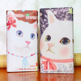 2 cat wallets - one white with pink bow - one purple pink collar