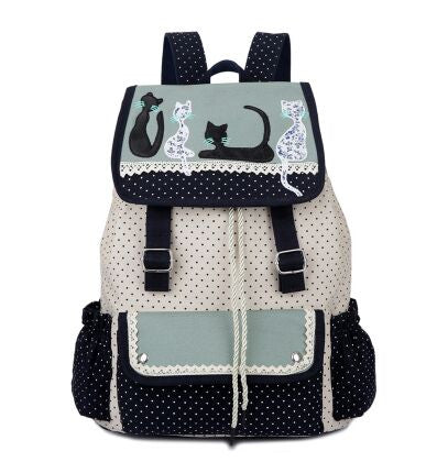 white blue and dark blue canvas cat backpack