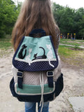 blue green and white canvas cat backpack