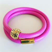 Leather wrap bracelet in hot pink with stainless steel magnetic clasp and gold tone filigree ball charm
