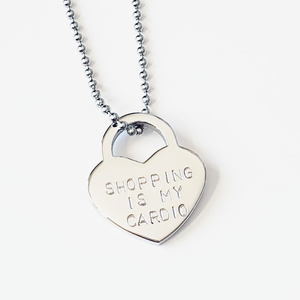 Padlock heart bag charm | shopping is my cardio | allure style