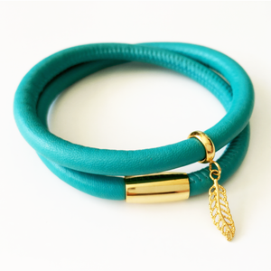 Teal double wrap leather bracelet with gold plated feather charm