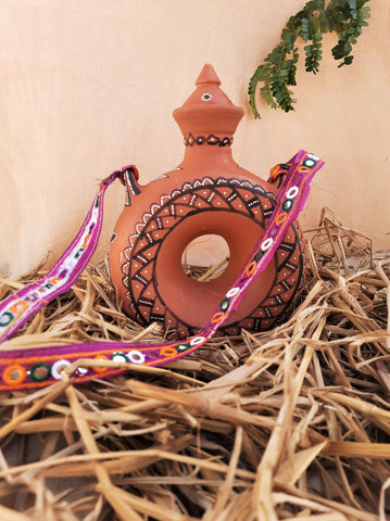 Terracotta water bottle in vintage style, traditional Indian terracotta water bottle