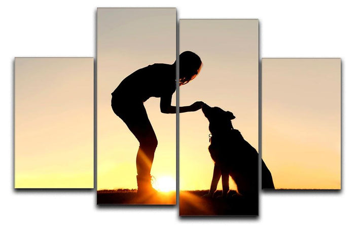 A silhouette of a girl sitting outside in the grass with her pet German Shepherd Mix Dog feeding him treats during training in front of a sunsetting sky. 4 Split Panel Canvas