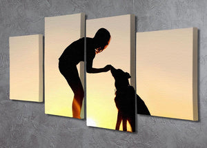 A silhouette of a girl sitting outside in the grass with her pet German Shepherd Mix Dog feeding him treats during training in front of a sunsetting sky. 4 Split Panel Canvas - Canvas Art Rocks - 2
