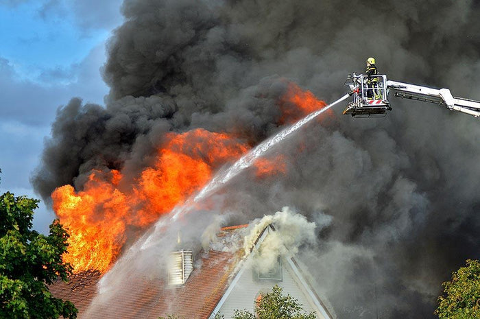 Aerial Firefighter Fights Large Fire Wall Mural Wallpaper