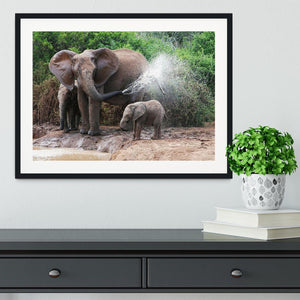African elephant mother and baby cooling off Framed Print - Canvas Art Rocks - 1