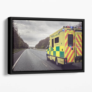 Ambulance responding to an emergency Floating Framed Canvas