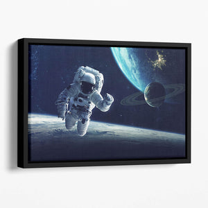 Astronaut at spacewalk Floating Framed Canvas