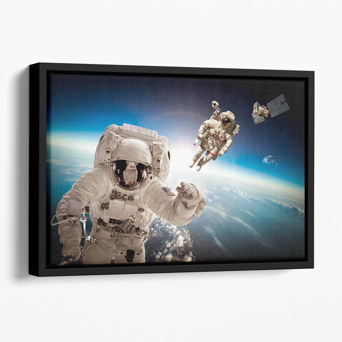 Astronaut in outer space Floating Framed Canvas