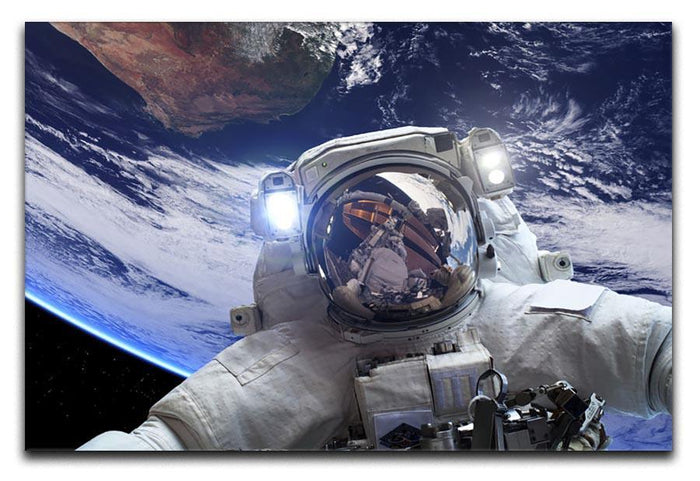 Astronaut in outer space against the backdrop Canvas Print or Poster