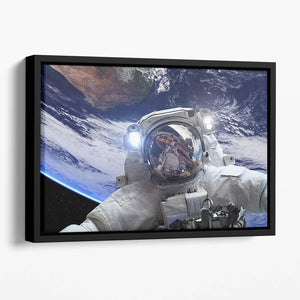 Astronaut in outer space against the backdrop Floating Framed Canvas