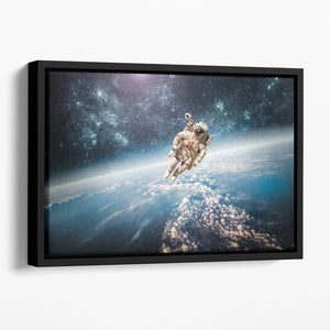 Astronaut in outer space planet earth Floating Framed Canvas