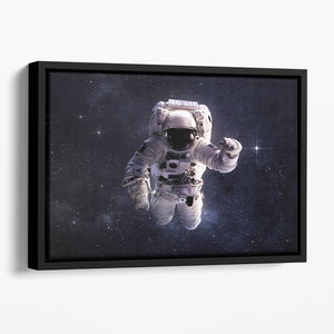 Astronaut in outer space with stars Floating Framed Canvas