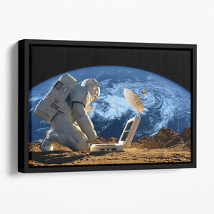 Astronaut working on the Moon Floating Framed Canvas