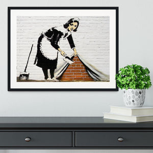 Banksy Maid Sweeping Under the Carpet Framed Print