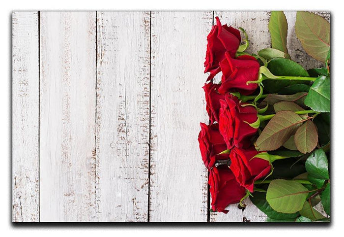 Bouquet of red roses on a light wooden background Canvas Print or Poster