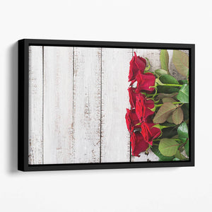 Bouquet of red roses on a light wooden background Floating Framed Canvas