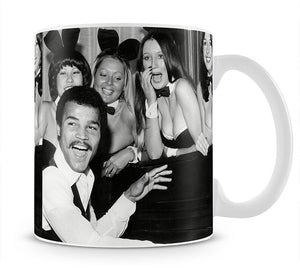Boxer John Conteh with bunny girls at the playboy club Mug - Canvas Art Rocks - 1