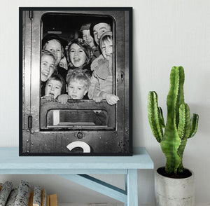 Cheerful train evacuees Framed Print - Canvas Art Rocks - 2