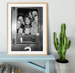 Cheerful train evacuees Framed Print - Canvas Art Rocks - 3