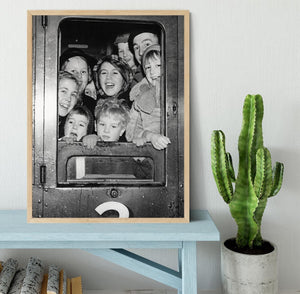 Cheerful train evacuees Framed Print - Canvas Art Rocks - 4