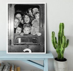 Cheerful train evacuees Framed Print - Canvas Art Rocks -6