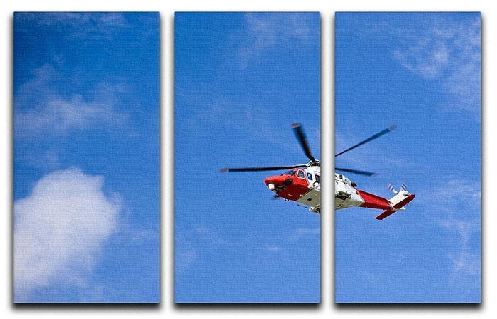 Coastguard helicopter in the blue sky 3 Split Panel Canvas Print