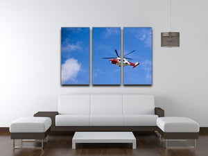 Coastguard helicopter in the blue sky 3 Split Panel Canvas Print - Canvas Art Rocks - 3