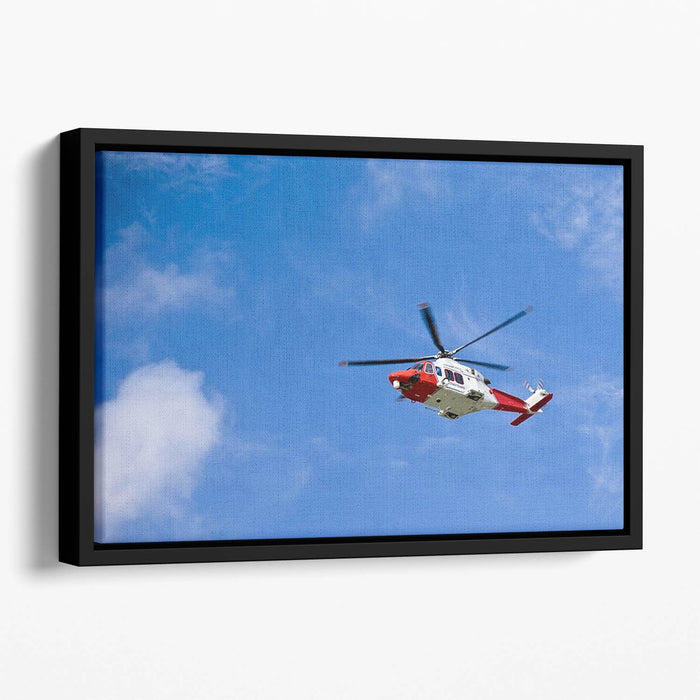 Coastguard helicopter in the blue sky Floating Framed Canvas