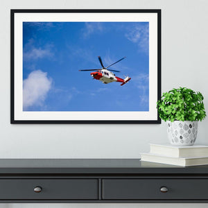 Coastguard helicopter in the blue sky Framed Print - Canvas Art Rocks - 1