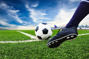 Foot kicking soccer ball Wall Mural Wallpaper - Canvas Art Rocks - 1