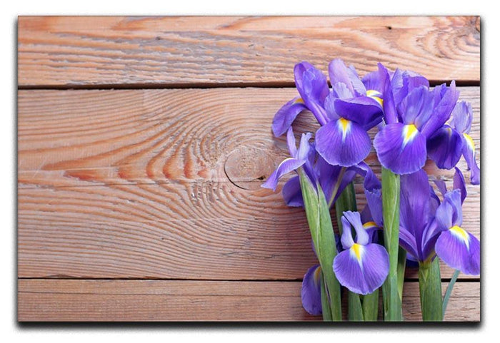 Iris on an old wooden background Canvas Print or Poster