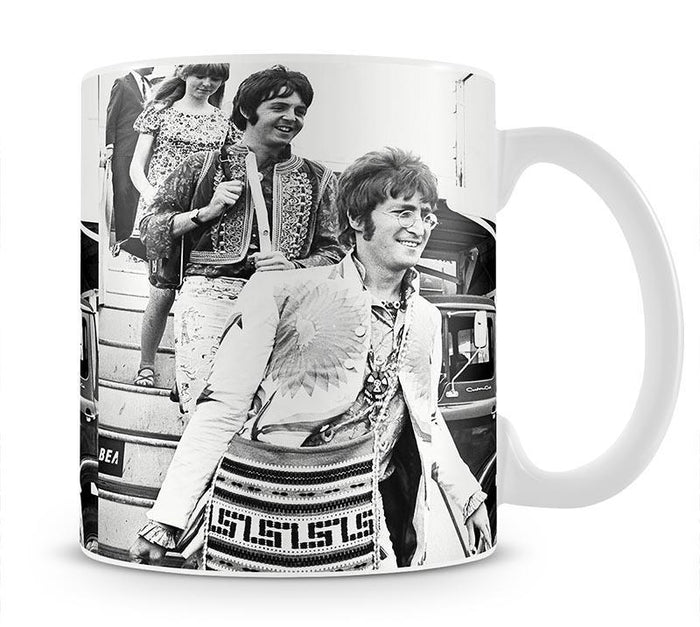 John Lennon Paul McCartney and Jane Asher getting off a plane Mug