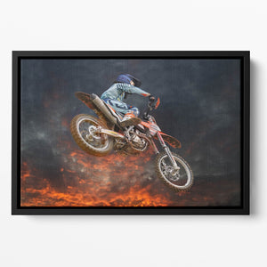 Jumping motocross rider Floating Framed Canvas